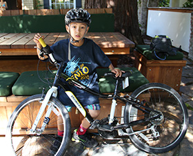 Here's my son Marco and his bike right after his 80K bike ride last year.  He spent the rest of the day jumping on our trampoline and climbing our playhouse.
