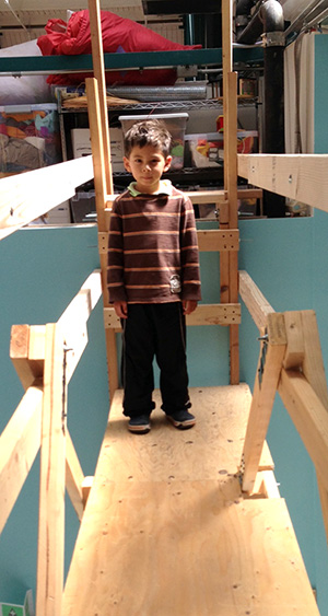 Nico's standing on the bridge he helped build, and the loft it accesses is behind him.  Yes, he's quite proud of himself.