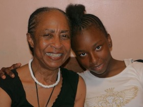 Hetty Fox, head of the New York Kids Foundation, and neighbor Lynnell Wiggins, 13.