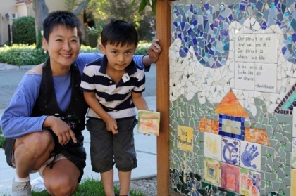 Posing next to our neighborhood mosaic are mosaic artist Jaying Wang and my son Marco.