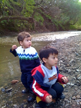 "Here are my two older boys a few years ago at our creek.  It's one of their favorite play places in the world, but according to many grown-ups, it's not a real ""playspace"" because it's not an official park."