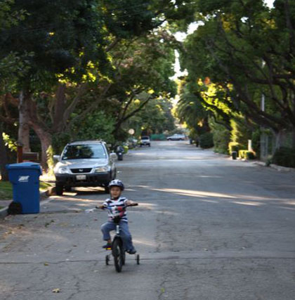 Here's Marco riding his bike on our street at age four. Don't worry - at that age, I never let him out of my sight while he rode on the street, but I did let him wander away from me a couple hundred feet or so.