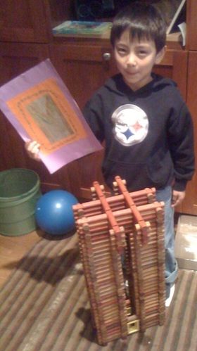 Here's Marco with one of his latest Lincoln Logs creations, made of parts from the 60s, 90s, and 00s.