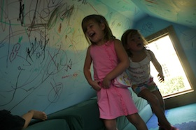 The inside of the playhouse in our back yard has proven to be a great 'platform' for kids' culture.