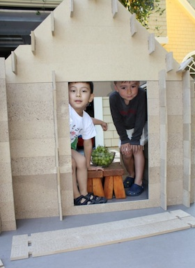 Here are my son Marco and a friend inside a Slotwood house they made at my neighborhood summer camp last year.