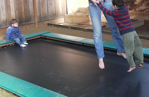Our new in-ground trampoline has quickly become the most valuable kid feature in our yard!