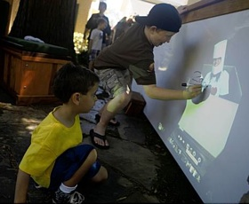Here's a photo from the SF Chronicle - two boys writing over a projected image on our white board in the front yard.
